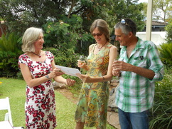 Celebrant handing certificate to couple